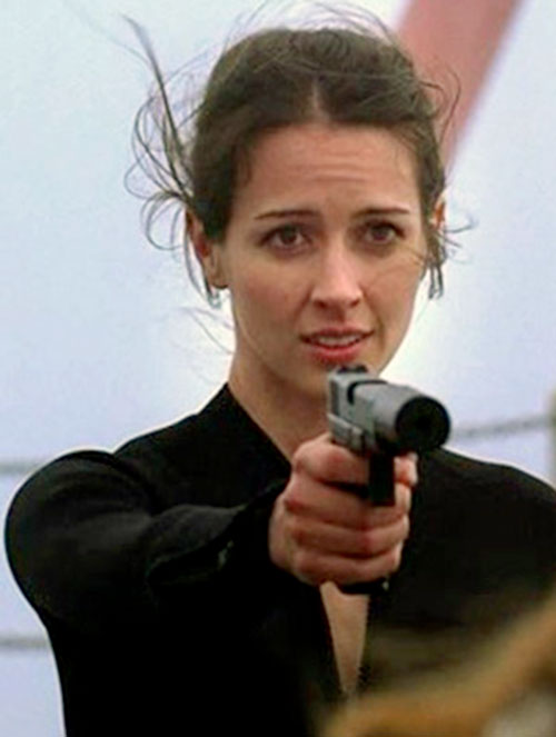 Kelly Peyton (Amy Acker in Alias) pointing a silenced pistol