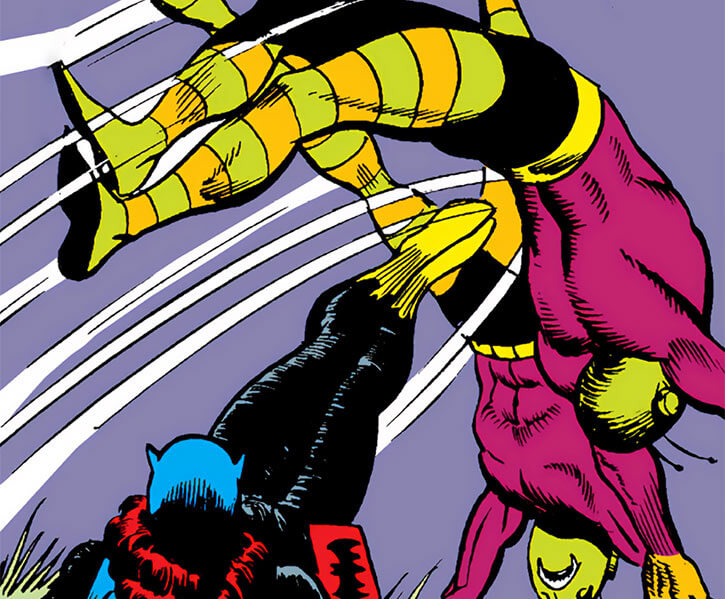 Batgirl (DC Comics) throwing Killer Moth henchmen with her legs