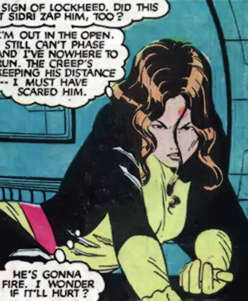 Kitty Pryde of the X-Men (Early) (Marvel Comics) knocked down but fighting