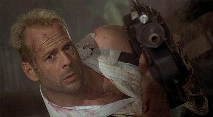 Korben Dallas on the floor, aiming a gun