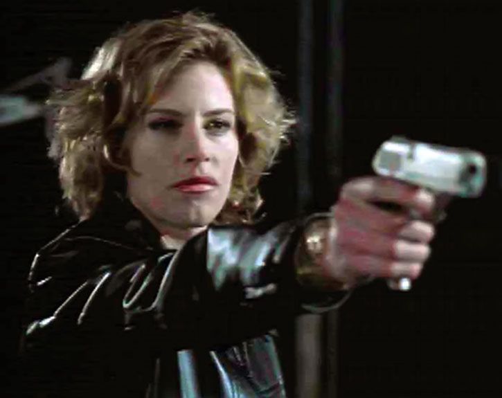 Lady Jayne (Julie Dupage) aiming a pistol