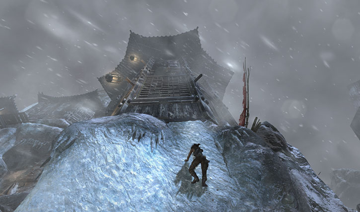 Lara Croft climbs an ice wall toward a pagoda