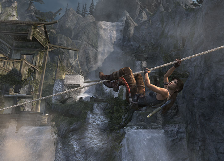 Lara Croft climbing up a zipline in front of a waterfall