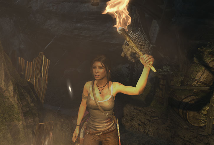 Lara Croft in a cave with a torch