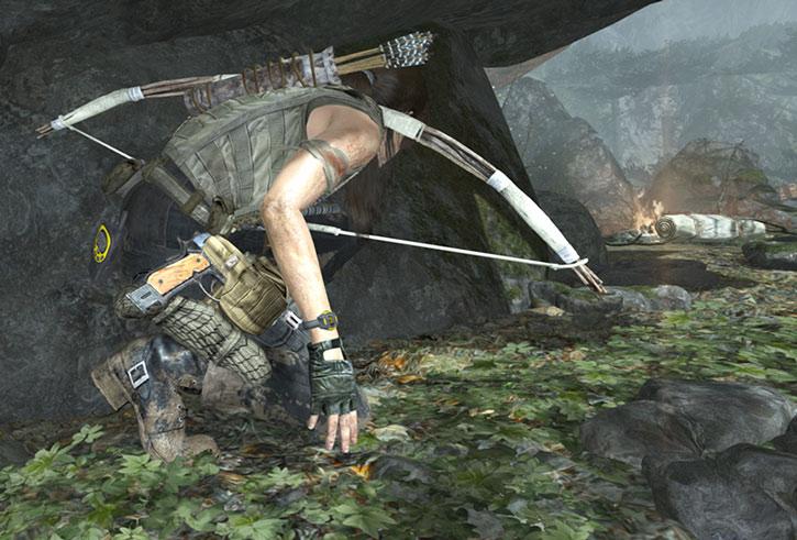 Lara Croft near her camp with a crude bow