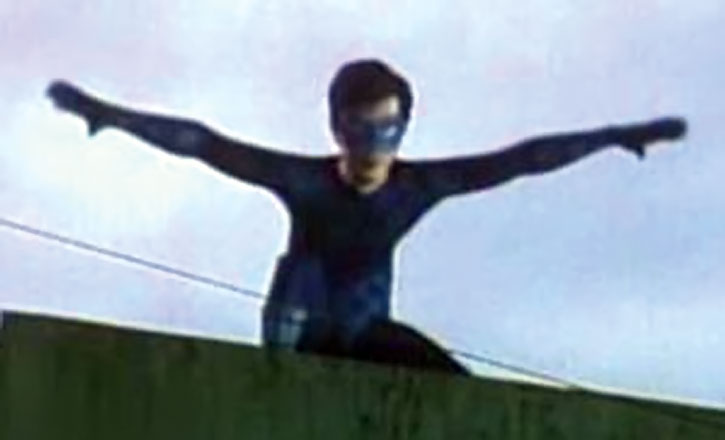 Lastikman (Mark Bautista) on a roof