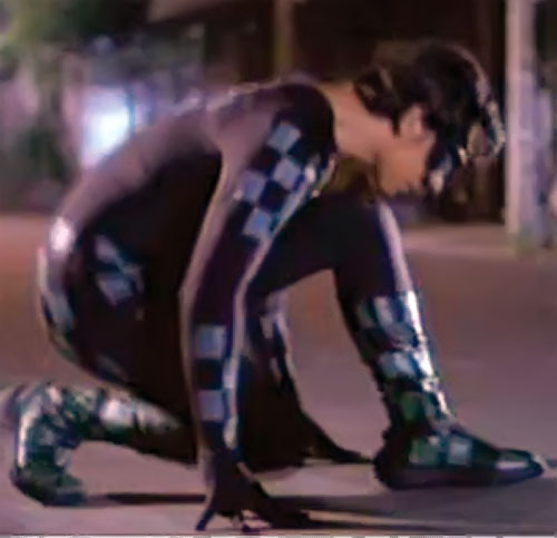 Lastikman (Mark Bautista version) kneeling dramatically on a street