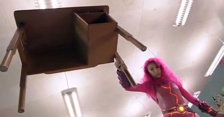 Lavagirl (Taylor Dooley) brandishes a desk