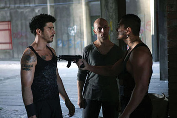 Leito (David Belle) and Tomasso facing a thug