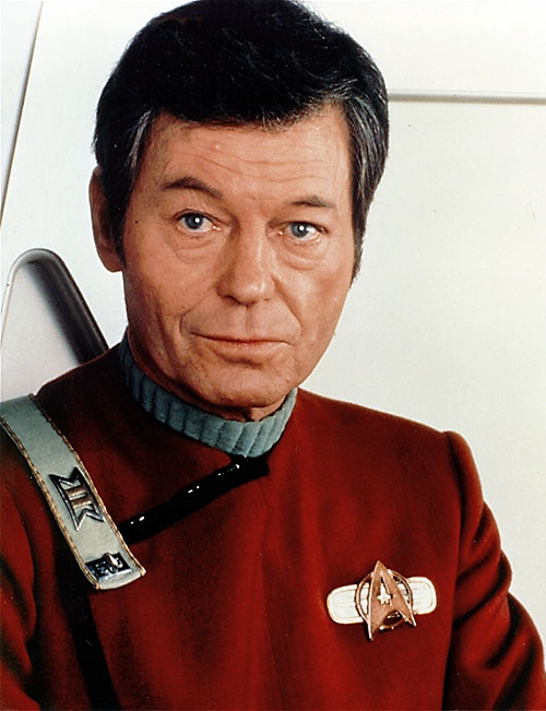 "Dr. Leonard ""Bones"" McCoy (Deforest Kelley in Star Trek) in a red uniform"