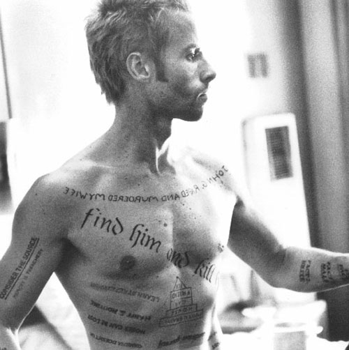 Leonard Shelby (Guy Pearce in Memento) and his tattoos
