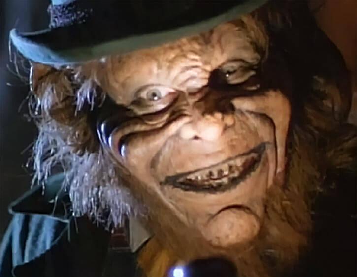 Leprechaun - Bad horror movies - Warwick Davis - Face closeup green hat