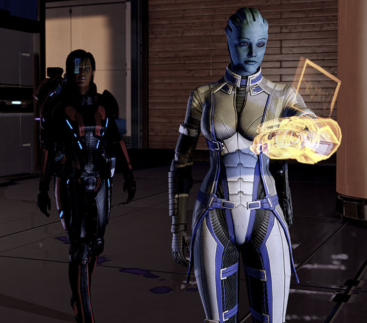Liara using her omni-tool with extended display in ME2
