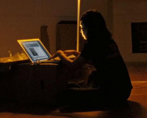 Lisbeth Salander (Movie version) (Noomi Rapace take) working MacBook