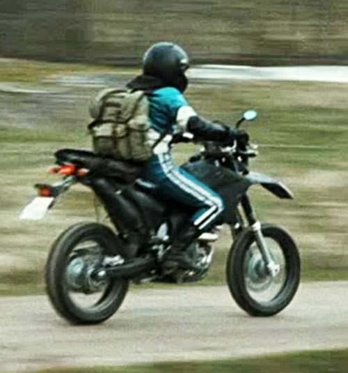 Lisbeth Salander (Movie version) blue track suit and motorbike