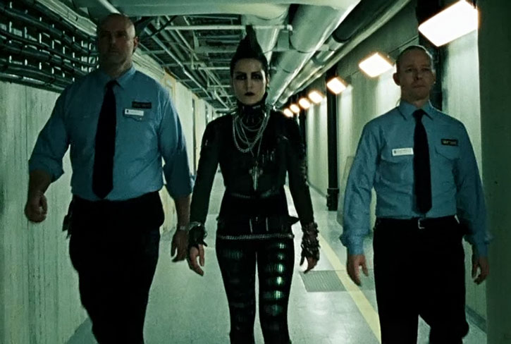Lisbeth Salander escorted by guards