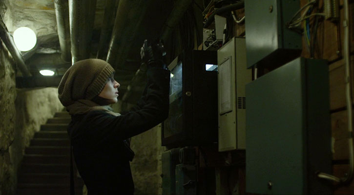 Lisbeth Salander tinkering with power boxes