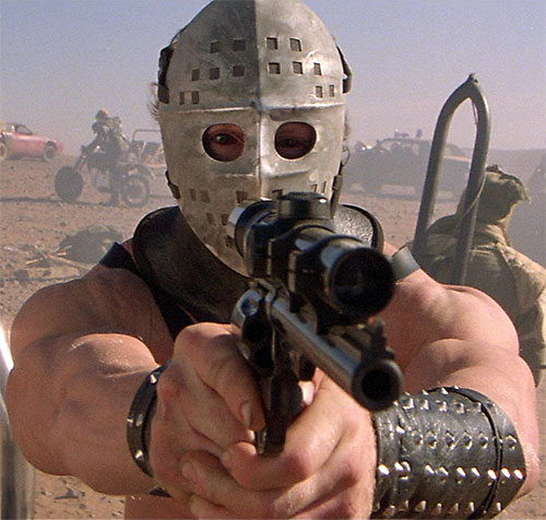 Lord Humungus (Kjell Nilsson in Mad Max) aiming his revolver