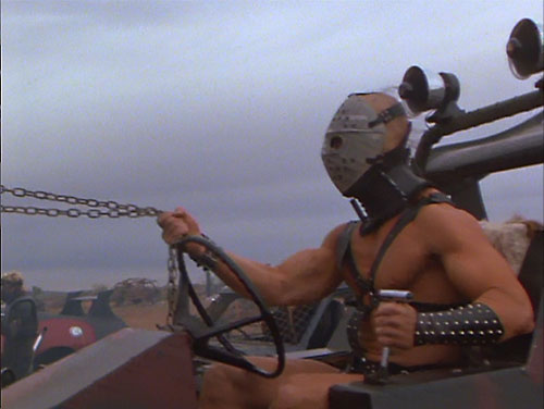 Lord Humungus (Kjell Nilsson in Mad Max) at the wheel