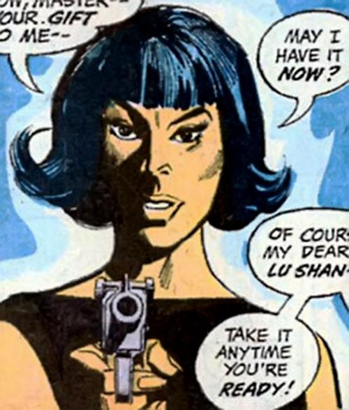 Lu Shan (Wonder Woman enemy) (DC Comics) pointing a pistol