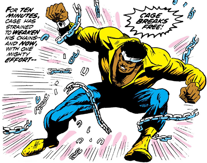 Power Man (Luke Cage) breaks free from his chains