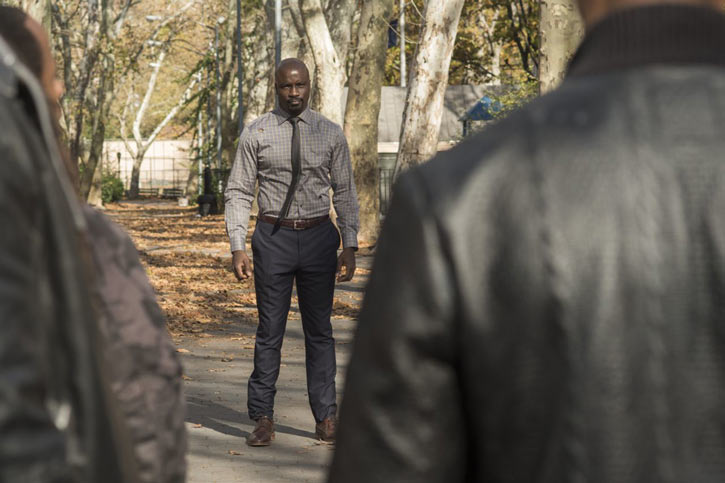 Luke Cage (Netflix version) character profile - facing two men in a park, in a suit