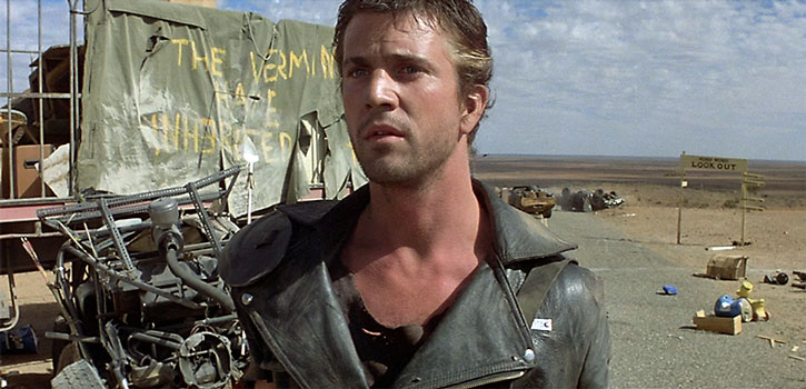 Mad Max (Mel Gibson) surveys the damage after a gang raid