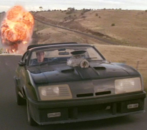 Mad Max (Mel Gibson) - V8 Interceptor driving away from an explosion