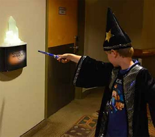 MagiQuest player with wand