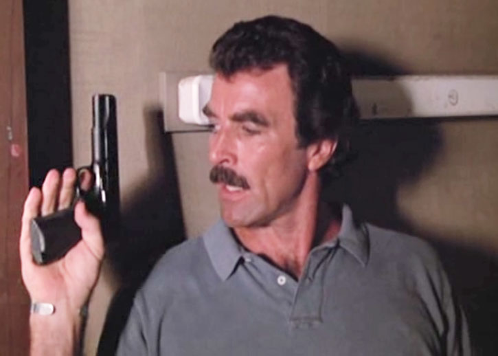 Magnum (Tom Selleck) with his .45 pistol at the ready