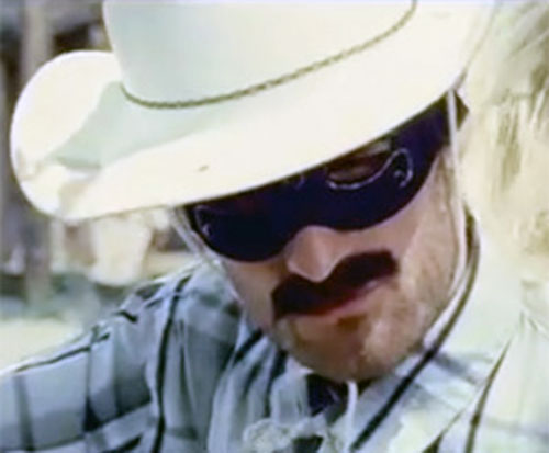 Man with no name (Knights of Cydonia) masked face closeup with white hat