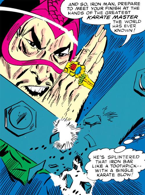 The early Mandarin (Iron Man enemy) (Marvel Comics) karate chops through an iron beam
