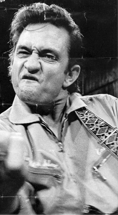 Old photo of Johnny Cash giving the finger