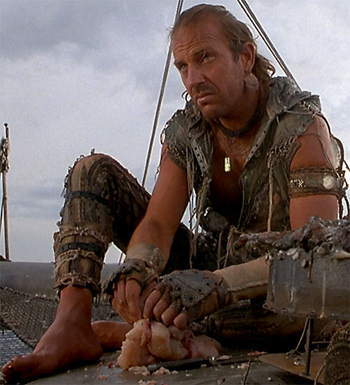 Mariner (Kevin Costner in Waterworld) preparing food