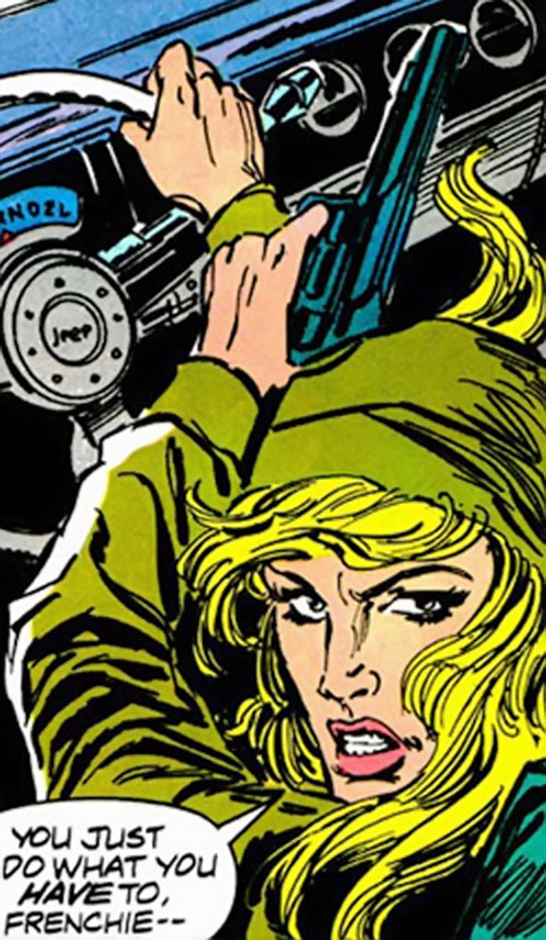 Marlene Alraune (Moon Knight) (Marvel Comics) with a headscarf and a magnum