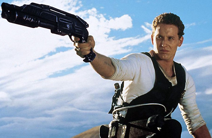 Johns (Cole Hauser) points a shotgun