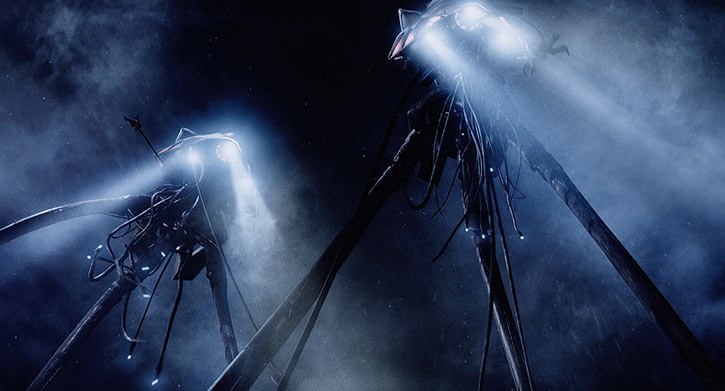 Martian tripods in the night, with searchlights