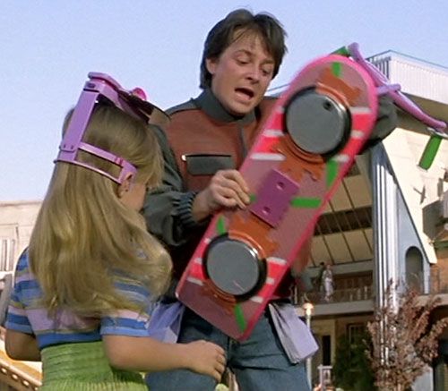 Marty McFly (Michael J Fox in Back to the Future) grabs an hoverboard from a little girl