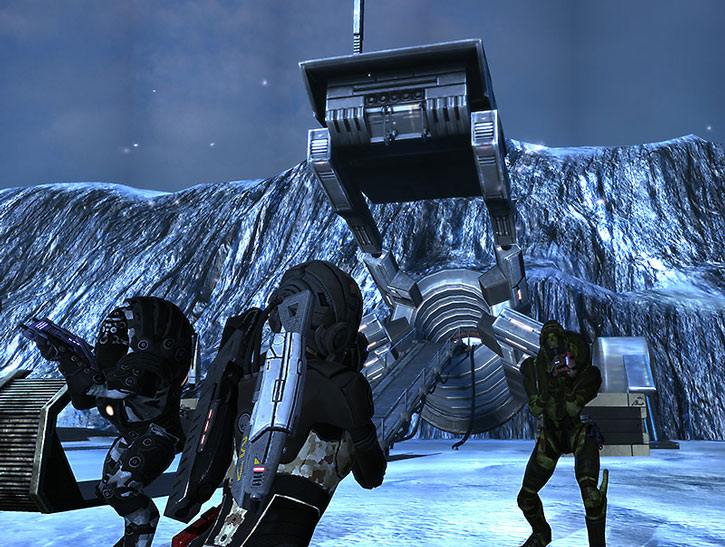 Commander Shepard, Wrex and Garrus about to enter a mine on an alien world