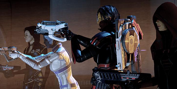 Commander Shepard, Miranda, Liara and Kasumi pointing their guns