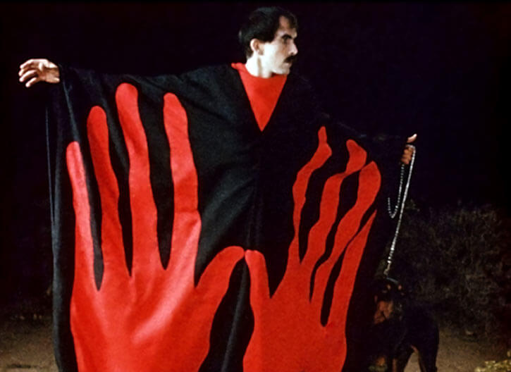 The Master in the movie Manos: the hand of fate with his robes and dog