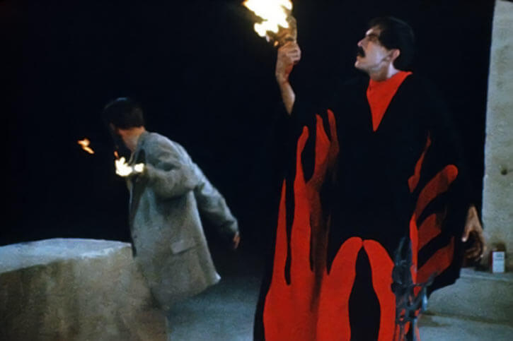 The Master in the movie Manos: the hand of fate with Torgo's burning hand