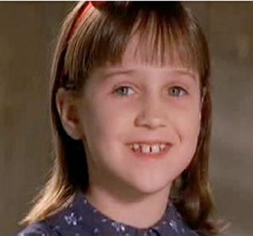 Matilda (Mara Wilson in Matilda) grinning