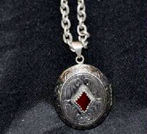 Matthew Tate (Billy Wirth in Charmed) warlock amulet closeup