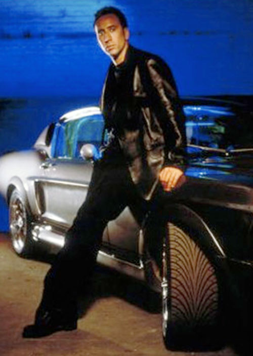 Memphis Raines (Nicolas Cage in Gone In 60 Seconds) sitting on an expensive car