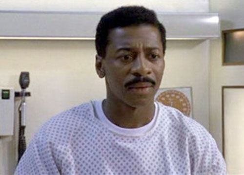 Meteor Man (Robert Townsend) in an hospital gown