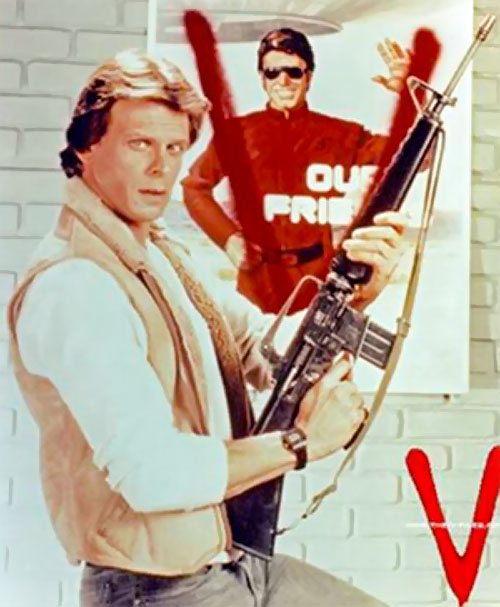 Mike Donovan (Marc Singer in V) with a M16 and a Visitors poster
