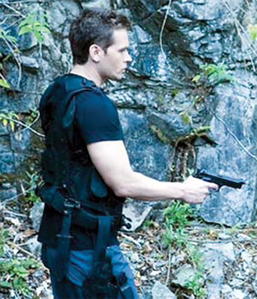 Michael Kenmore (Connor Trinneer in Stargate Atlantis) with a M9 pistol