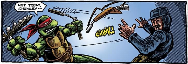 Michealangelo disarms a man using his nunchuks