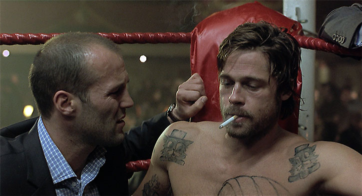 Mickey O'Neil (Brad Pitt) smoking during an illegal boxing match